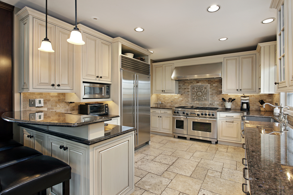 Upscale kitchen in luxury home with breakfast bar
